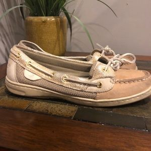 Slightly worn gold and tan sperry